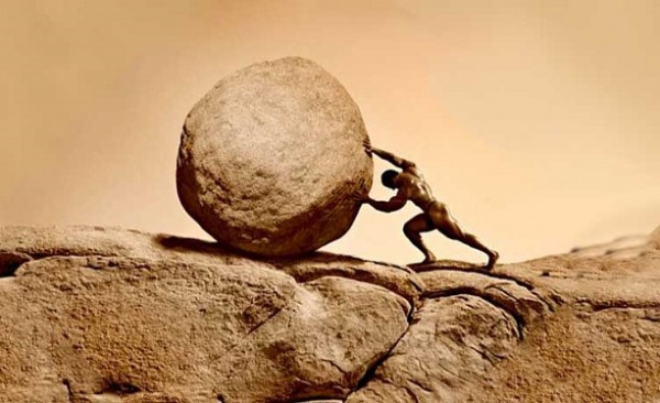 man-pushing-up-a-rock